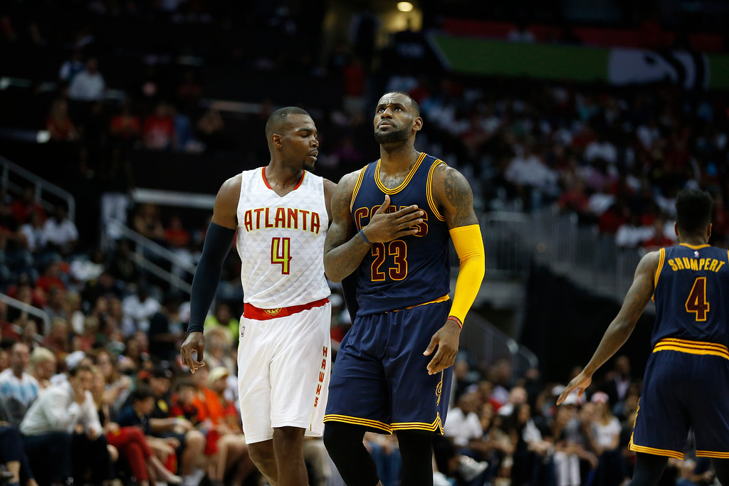 . Atlanta Hawks forward Paul Millsap (4) and Cleveland Cavaliers forward LeBron James (23) walk on the court in there first half  of Game 4 of the second-round NBA basketball playoff series, Sunday, May 8, 2016, in Atlanta. (AP Photo/John Bazemore)