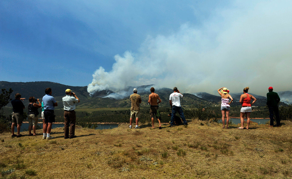 . People watch the High Park fire from Horsetooth Reservoir, Monday, June 11, 2012, near Fort Collins. The fire continues to grow today. RJ Sangosti, The Denver Post