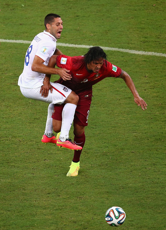 . Clint Dempsey of the United States collides with Bruno Alves of Portugal during the 2014 FIFA World Cup Brazil Group G match between the United States and Portugal at Arena Amazonia on June 22, 2014 in Manaus, Brazil.  (Photo by Elsa/Getty Images)