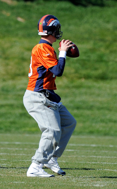 . Denver Broncos quarterback Peyton Manning (18) drops back to pass during practice October 24, 2013 at Dove Valley. (Photo by John Leyba/The Denver Post)