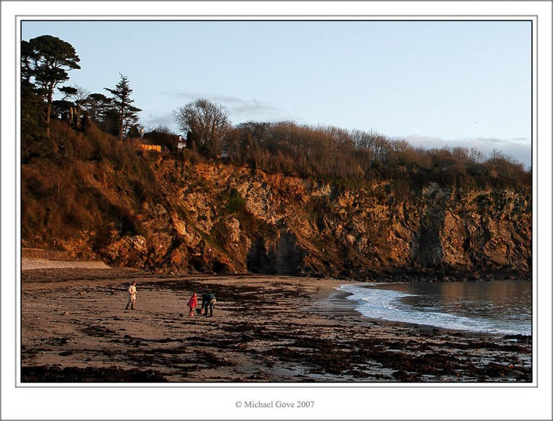 Family out for an early morning beach walk (73109219).jpg