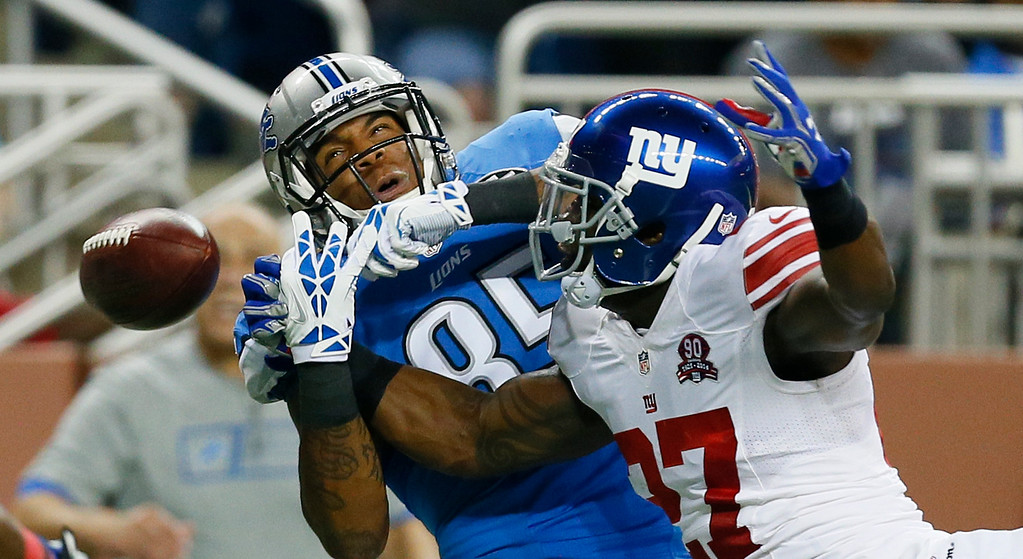 . New York Giants strong safety Stevie Brown deflects a pass intended for Detroit Lions tight end Eric Ebron (85) during the first quarter of an NFL football game in Detroit, Monday, Sept. 8, 2014. (AP Photo/Paul Sancya)