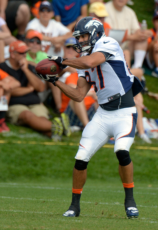 . Denver Broncos WR Eric Decker (87) catches a pass during training camp August 1, 2013 at Dove Valley. (Photo By John Leyba/The Denver Post)