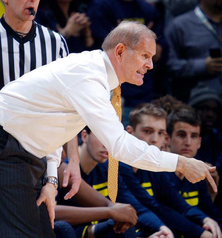 . Michigan coach John Beilein gives instructions during the second half of an NCAA college basketball game against Michigan State, Sunday, Feb. 1, 2015, in East Lansing, Mich. Michigan State won 76-66 in overtime. (AP Photo/Al Goldis)