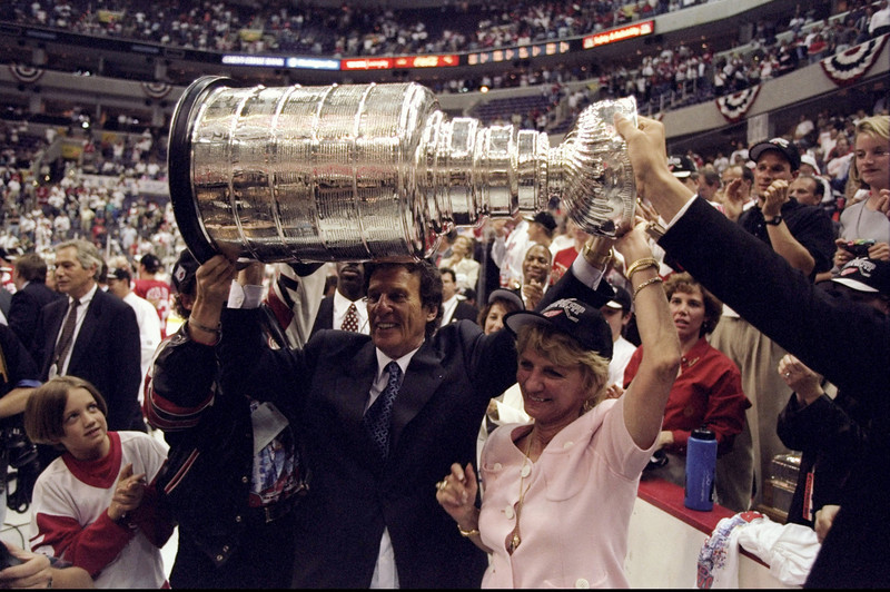 . 16 Jun 1998:  Team owners of the Detroit Red Wings Mike and Marian Ilitch hold the Stanley Cup trophy up over their heads during the Stanley Cup Finals game against the Washington Capitals at the MCI Center in Washington, D. C.. The Red Wings defeated the Capitals 4-1. Mandatory Credit: Robert Laberge  /Allsport