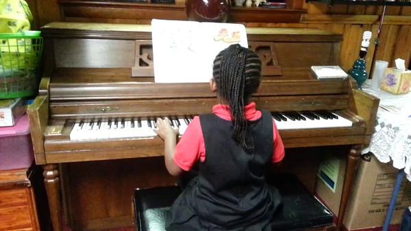 Vanessa Shayla Harris playing piano