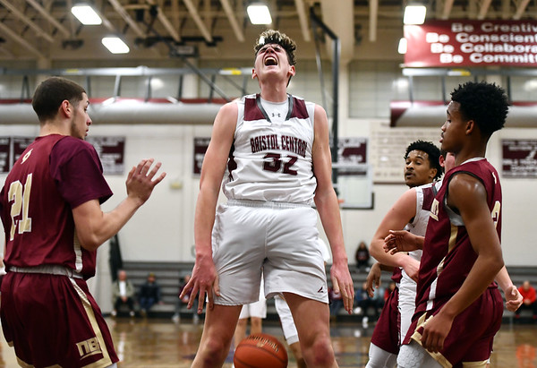 1/3/2020 Mike Orazzi | StaffrBristol Central High School's Donovan Clingan (32) after a dunk during Friday night's boys basketball game with New Britain in Bristol.
