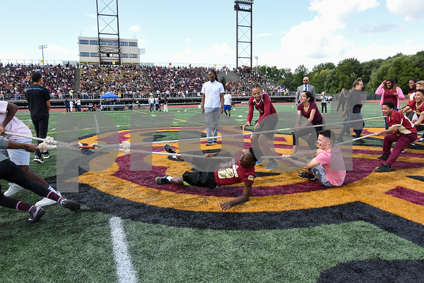 09/08/17 Wesley Bunnell | Staff New Britain High School held a pep rally at Veteran's Stadium on Friday afternoon. NBHS junior and senior year students, L, take on freshman and sophomore in a tug-of-war at midfield with the upperclassmen coming out on top.