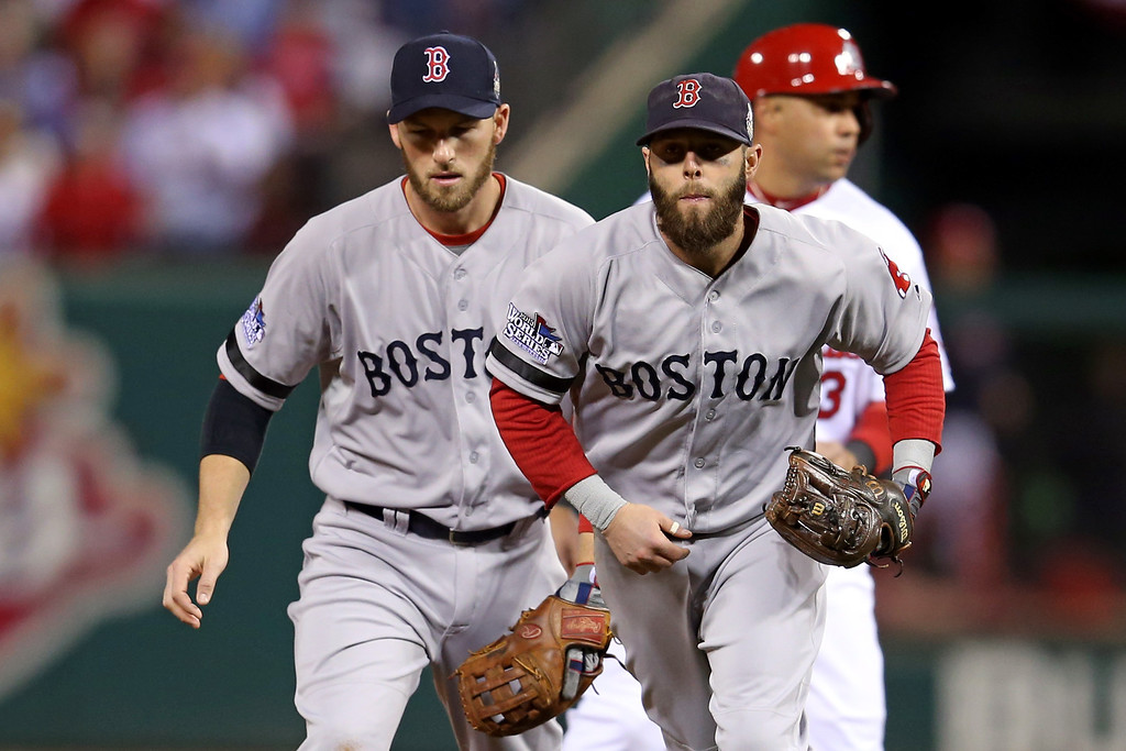 . Stephen Drew #7 and Dustin Pedroia #15 of the Boston Red Sox react after a double play ending the second inning against the St. Louis Cardinals during Game Five of the 2013 World Series at Busch Stadium on October 28, 2013 in St Louis, Missouri.  (Photo by Rob Carr/Getty Images)