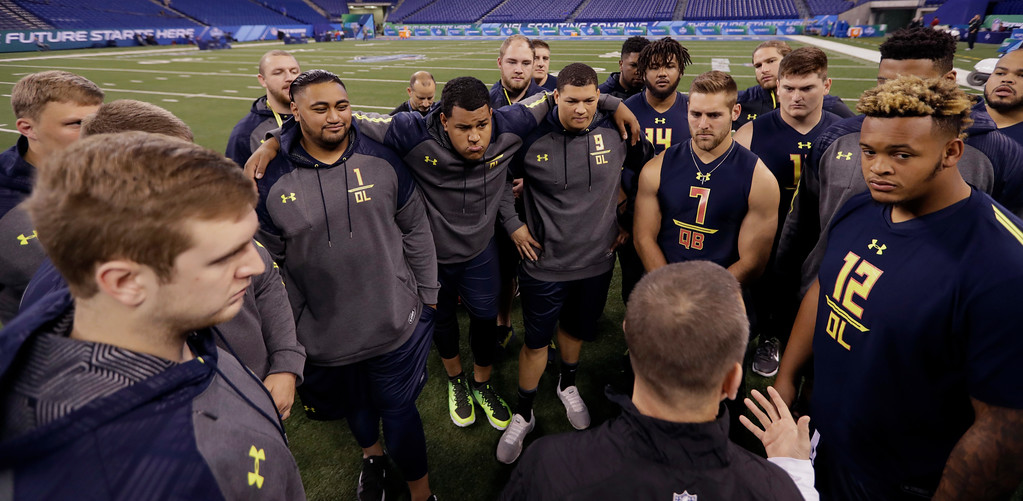 . Participants are given instructions at the NFL football scouting combine Friday, March 3, 2017, in Indianapolis. (AP Photo/David J. Phillip)