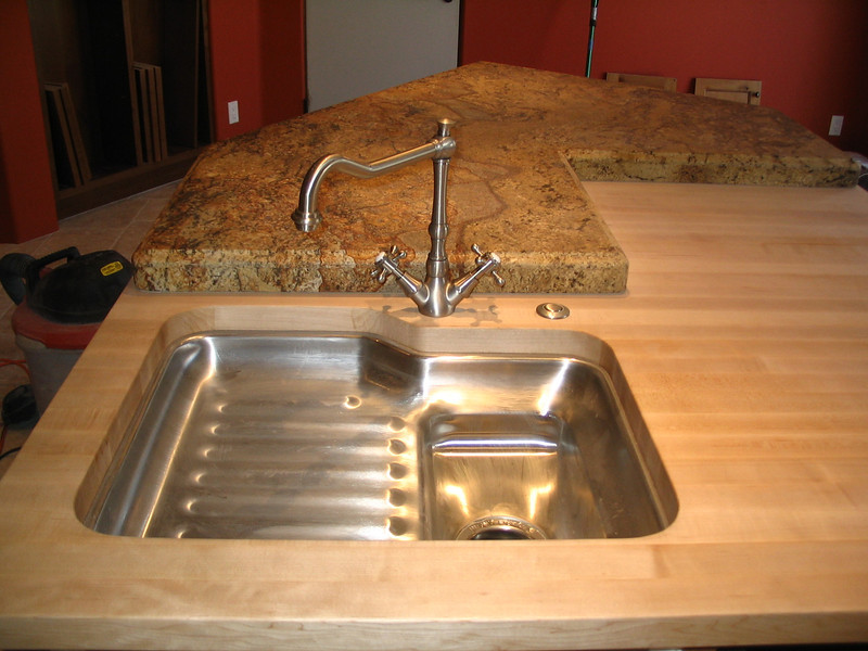 The faucet has been installed at the prep sink.