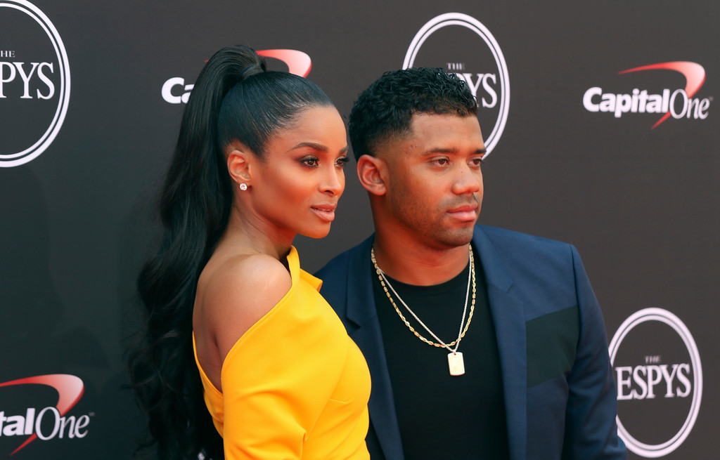 . Ciara, left, and Seattle Seahawks\' Russell Wilson arrive at the ESPY Awards at Microsoft Theater on Wednesday, July 18, 2018, in Los Angeles. (Photo by Willy Sanjuan/Invision/AP)