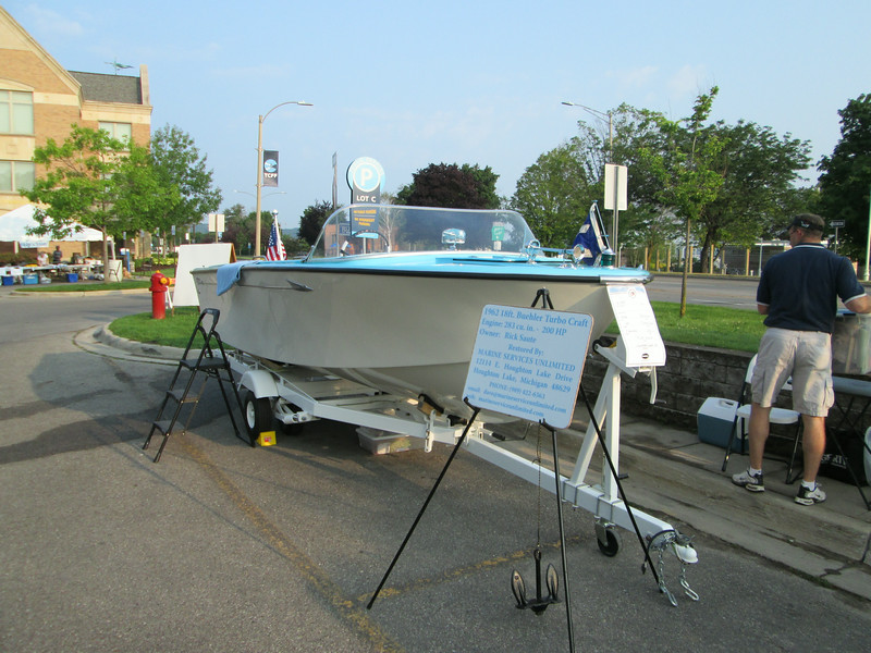 Setting up the display at the Boats on the board walk boat show in Traverse City Michigan August 2014.