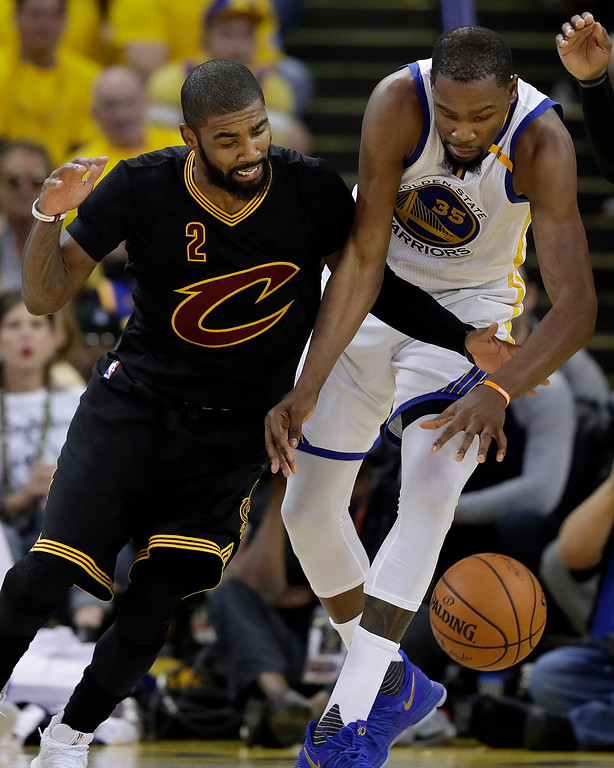 . Cleveland Cavaliers guard Kyrie Irving (2) tries to take the ball from Golden State Warriors forward Kevin Durant (35) during the second half of Game 2 of basketball\'s NBA Finals in Oakland, Calif., Sunday, June 4, 2017. (AP Photo/Marcio Jose Sanchez)