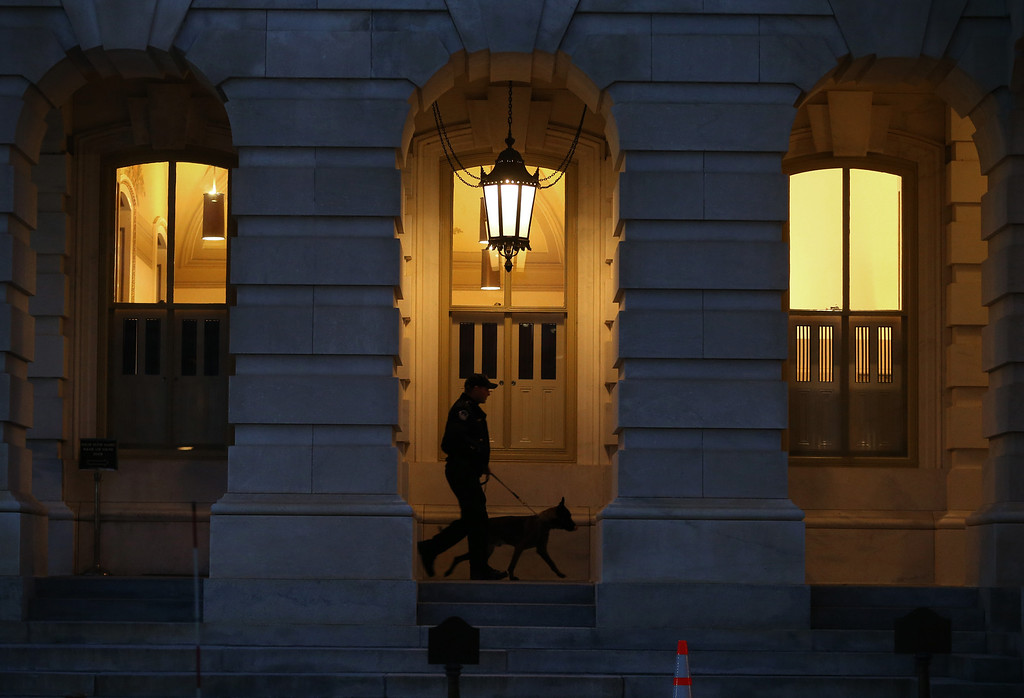 . WASHINGTON, DC - JANUARY 28:  A U.S. Capitol Police officer and police dog patrol the U.S. Capitol before President Barack Obama\'s State of the Union address before a joint session of Congress, on January 28, 2014 in Washington, DC. In his fifth State of the Union address, Obama is expected to emphasize on healthcare, economic fairness and new initiatives designed to stimulate the U.S. economy with bipartisan cooperation.  (Photo by Mark Wilson/Getty Images)