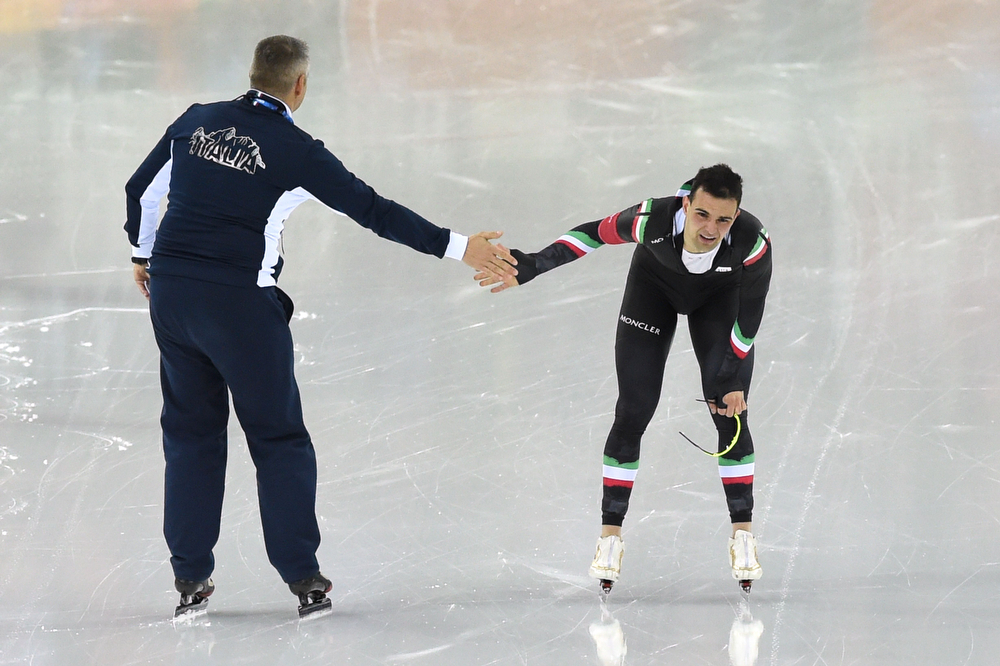 . Italy\'s Andrea Giovannini shakes hands with his coach after competing in the Men\'s Speed Skating 5000m at the Adler Arena during the 2014 Sochi Winter Olympics on February 8, 2014. (DAMIEN MEYER/AFP/Getty Images)