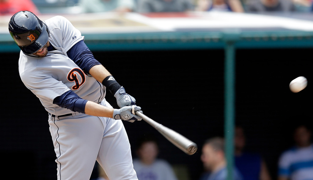 . Detroit Tigers\' J.D. Martinez hits a two-run home run off Cleveland Indians starting pitcher Carlos Carrasco in the seventh inning of a baseball game, Wednesday, June 24, 2015, in Cleveland. Yoenis Cespedes scored on the play. (AP Photo/Tony Dejak)