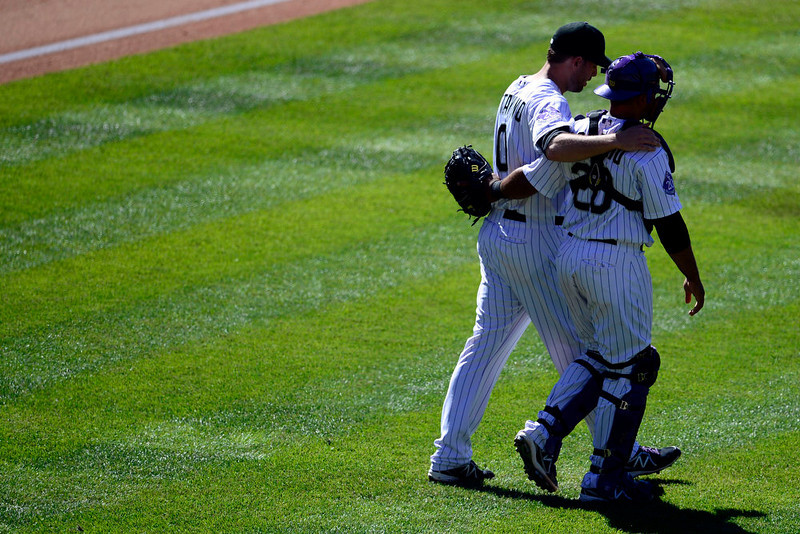 . Colorado Rockies pitcher Adam Ottavino (0) puts his arm around catcher Wilin Rosario (20) after finishing off the Los Angeles Dodgers during the ninth inning of the Rockies\' 7-2 win in Denver. The Colorado Rockies hosted the Los Angeles Dodgers at Coors Field. (Photo by AAron Ontiveroz/The Denver Post)