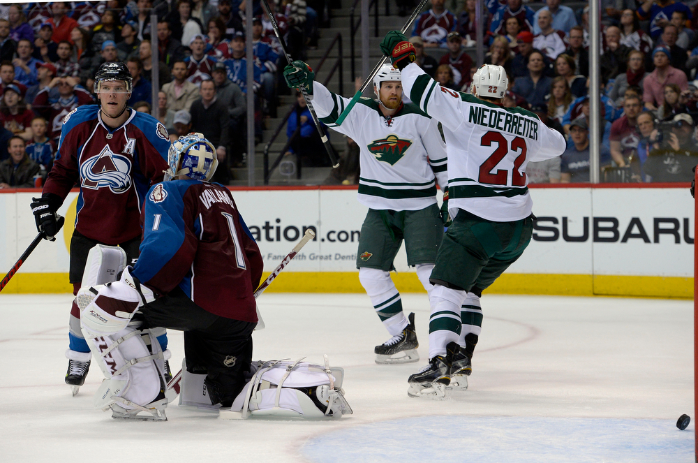 . Kyle Brodziak (21) of the Minnesota Wild celebrates scoring the fourth goal of the game for Minnesota during the second period of action with Nino Niederreiter (22) of the Minnesota Wild. The Colorado Avalanche hosted the Minnesota Wild for the first playoff game at the Pepsi Center on Thursday, April 17, 2014. (Photo by John Leyba/The Denver Post)