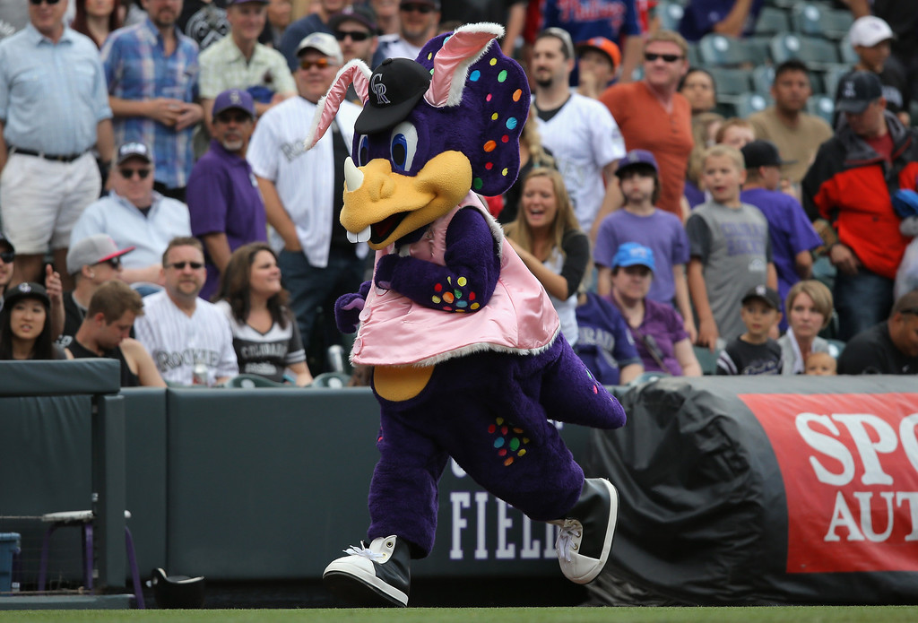 . Dinger the mascot for the Colorado Rockies is dressed in Easter costume as he supports the team against the Philadelphia Phillies at Coors Field on April 20, 2014 in Denver, Colorado. The Phillies defeated the Rockies 10-9.  (Photo by Doug Pensinger/Getty Images)