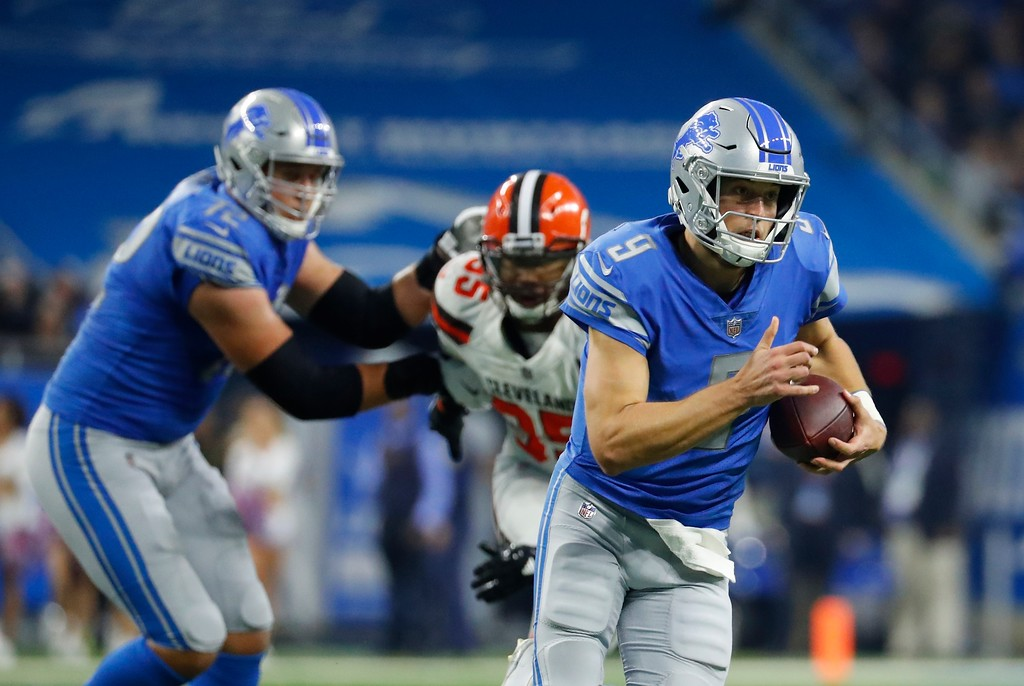 . Detroit Lions quarterback Matthew Stafford scrambles during the first half of an NFL football game against the Cleveland Browns, Sunday, Nov. 12, 2017, in Detroit. (AP Photo/Rick Osentoski)