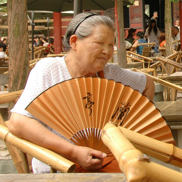 Chinese Woman with Fan - Chengdu, China