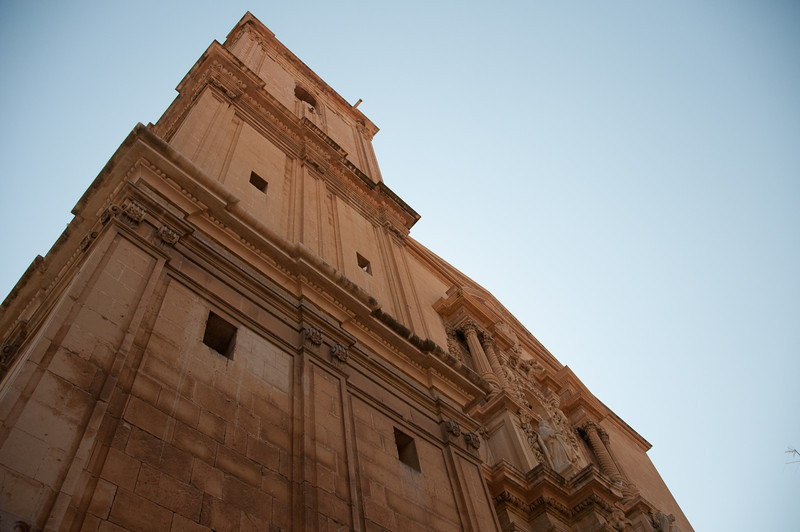 Looking up the facade of Basilica de Santa Maria in Elche, Alicante, Spain