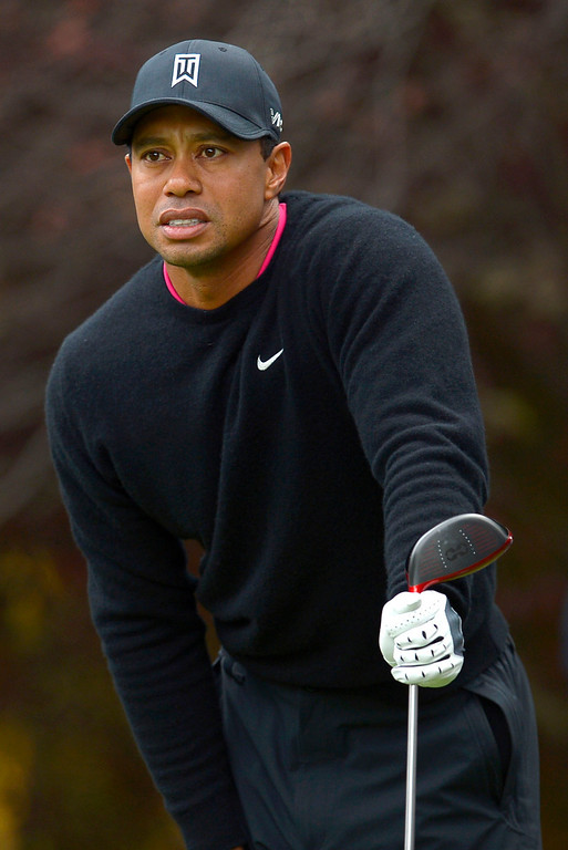 . Tiger Woods keeps an eye on his tee shot on the second hole during the second round of the Northwestern Mutual World Challenge golf tournament at Sherwood Country Club, Friday, December 6, 2013, in Thousand Oaks, Calif. (Andy Holzman/Los Angeles Daily News)