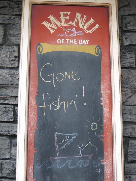 "Minuteman Fried Clams menu board. ""Gone Fishin'!"""