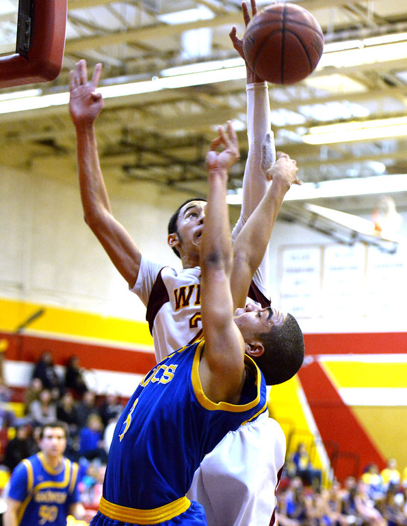 . Wilson\'s Kevin Price (21) blocks the shot of San Dimas\' Greyson McGee (C) (3) in the first half of a prep basketball game at Wilson High School in Hacienda Heights, Calif., on Friday, Jan. 31, 2014. (Keith Birmingham Pasadena Star-News)