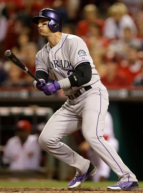 . Colorado Rockies\' Troy Tulowitzki hits a two-run home run off Cincinnati Reds relief pitcher Sam LeCure in the eighth inning of a baseball game, Tuesday, June 4, 2013, in Cincinnati. Colorado won 5-4. (AP Photo/Al Behrman)