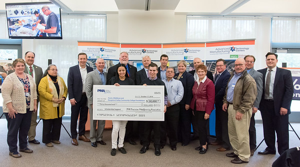 10/17/18 Wesley Bunnell | Staff The Precision Metalforming Association's New England Division donated $30,000 towards scholarships for Tunxis, Naugatuck Valley & Middlesex Community College's manufacturing programs. Naugatuck Community College's student Stephanie Maldonado and Tunxis' student James Sanders hold the ceremonial check surrounded by Naugatuck Community College President Dr. Daisy Cocco De Filippis, 3rd from L, Senator Chris Murphy, CSCU President Mark Ojakian, Dr. James Lobelia and PMA representatives.