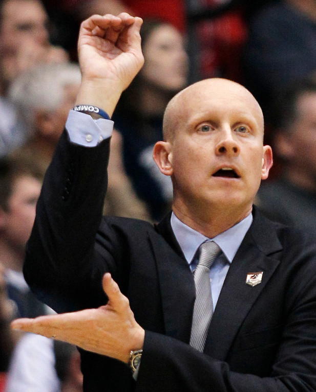 . Xavier coach Chris Mack calls a play against North Carolina State during the first half of a first-round game of the NCAA college basketball tournament, Tuesday, March 18, 2014, in Dayton, Ohio. (AP Photo/Skip Peterson)