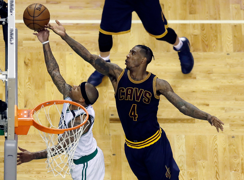 . Cleveland Cavaliers guard Iman Shumpert, right, tips the ball as Boston Celtics guard Isaiah Thomas shoots during the second quarter of Game 1 of the NBA basketball Eastern Conference finals, Wednesday, May 17, 2017, in Boston. (AP Photo/Charles Krupa)