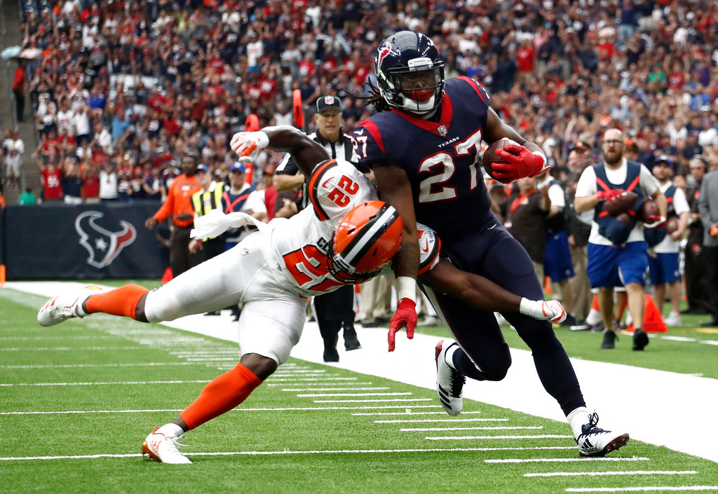 . Cleveland Browns safety Jabrill Peppers (22) pushes Houston Texans running back D\'Onta Foreman (27) out of bounds after Foreman caught a pass near the end zone in the first half of an NFL football game, Sunday, Oct. 15, 2017, in Houston. (AP Photo/Eric Gay)