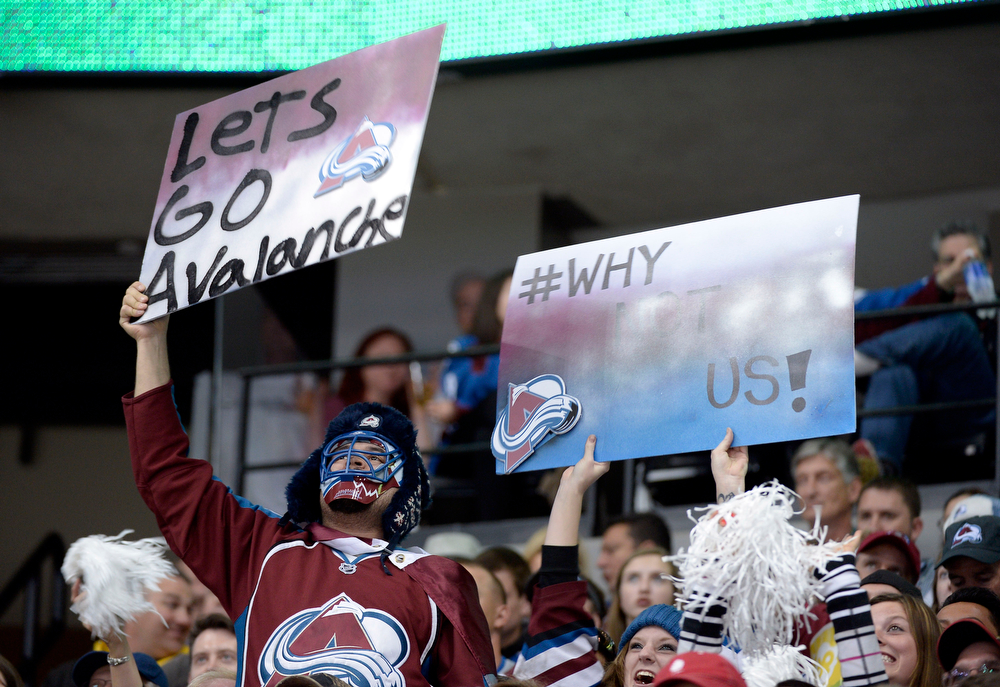 . Fans cheer on the Avalanche during the second period of action. The Colorado Avalanche hosted the Minnesota Wild for the first playoff game at the Pepsi Center on Thursday, April 17, 2014. (Photo by John Leyba/The Denver Post)