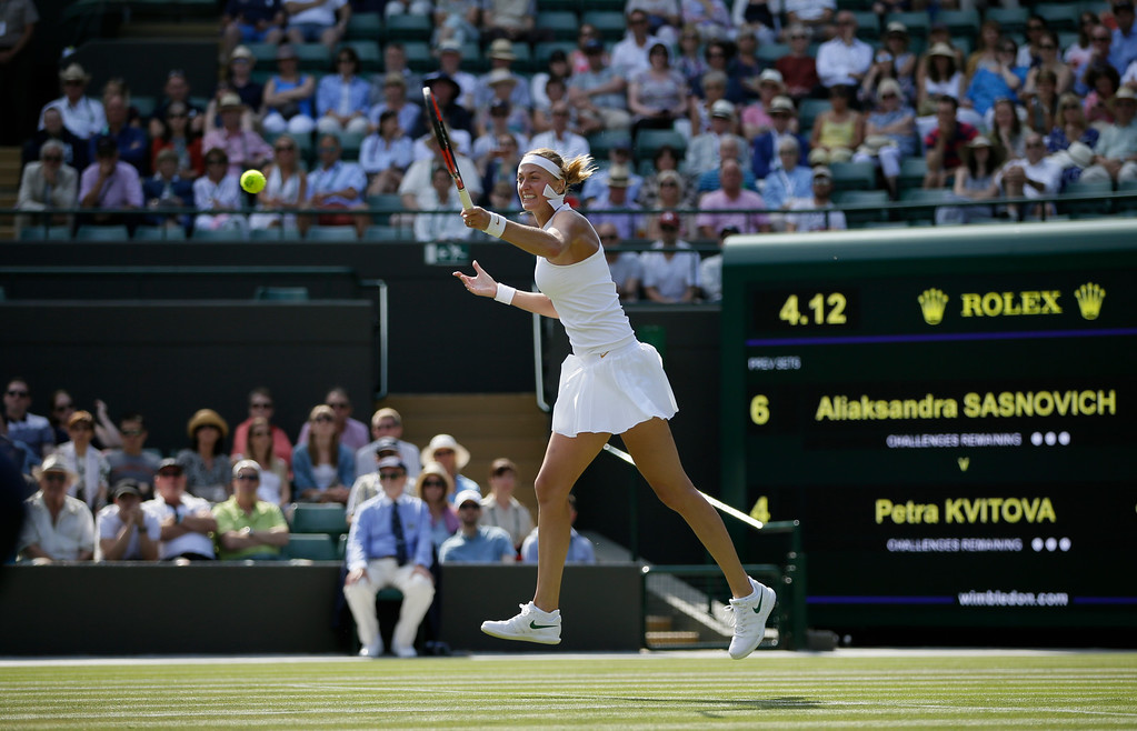 . Petra Kvitova of the Czech Republic returns a ball to Aliaksandra Sasnovich of Belarus during their women\'s singles match on the second day at the Wimbledon Tennis Championships in London, Tuesday July 3, 2018. (AP Photo/Tim Ireland)