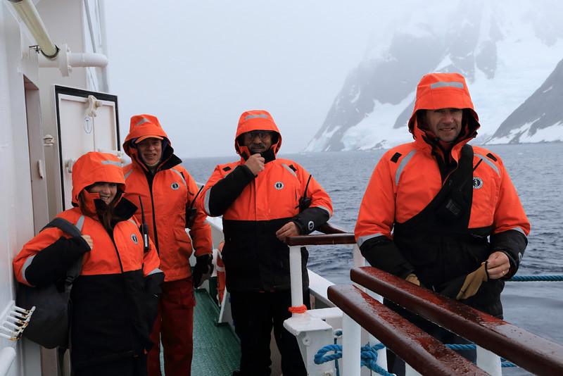 """Antarctica - Jan 2013 - Sergey Vavilov Circle Trip, The One Ocean Expedition get  staff ready for a shore landing: (L_R) Katie Murray (Historian), Steve Bailey (ornithologist) he kept us well aware of all the bird sittings during the trip, Ira Meyer (Photographer), and Graham Charles the Expedition Leader.  Ira's new book """"ICE"""" is spectacular:  http://irameyer.com/about_ira/my_book.asp?product_id=MyBook2"""