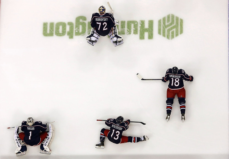 . Steve Mason #1, Sergei Bobrovsky #72, Cam Atkinson #13, and R.J. Umberger #18, all of the Columbus Blue Jackets, stretch prior to the start of the game against the Colorado Avalanche on March 3, 2013 at Nationwide Arena in Columbus, Ohio. (Photo by Kirk Irwin/Getty Images)