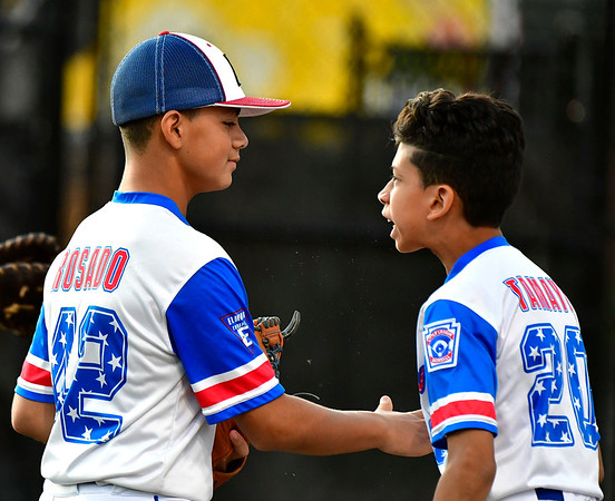 8/10/2019 Mike Orazzi | Staff New Jersey Elmora Youth Little League's J.R. Rosado (28) and Jaime Tamayo (20) during Saturday's Mid Atlantic Final baseball game with New York at Breen Field in Bristol, Conn.
