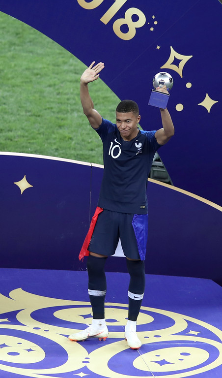 . France\'s Kylian Mbappe holds his FIFA Young Player award at the end of the final match between France and Croatia at the 2018 soccer World Cup in the Luzhniki Stadium in Moscow, Russia, Sunday, July 15, 2018. (AP Photo/Thanassis Stavrakis)