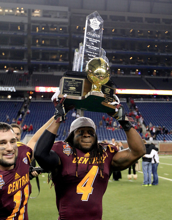 . Central Michigan defensive back Jahleel Addae (4) holds the trophy after their 24-21 win over Western Kentucky in the Little Caesars Pizza Bowl NCAA college football game at Ford Field in Detroit, Wednesday, Dec. 26, 2012. (AP Photo/Carlos Osorio)