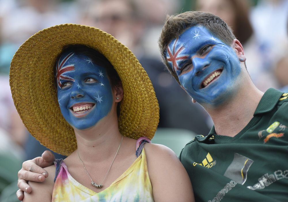 . Australian fans with a painted facees watch Germany\'s Dustin Brown play against Australia\'s Lleyton Hewitt during their second round men\'s singles match on day three of the 2013 Wimbledon Championships tennis tournament at the All England Club in Wimbledon, southwest London, on June 26, 2013. Brown won 6-4, 6-4, 6-7, 6-2. ADRIAN DENNIS/AFP/Getty Images
