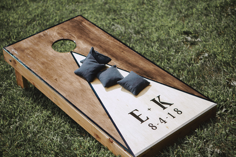 "A custom made bean bag toss with ""E+K 8-4-18"" Printed on it."