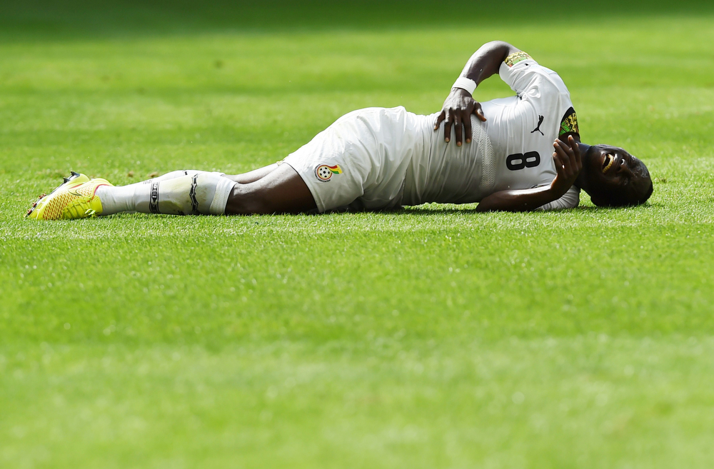 . Ghana\'s midfielder Emmanuel Agyemang Badu is injured during the Group G football match between Portugal and Ghana at the Mane Garrincha National Stadium in Brasilia during the 2014 FIFA World Cup on June 26, 2014.  (FRANCISCO LEONG/AFP/Getty Images)