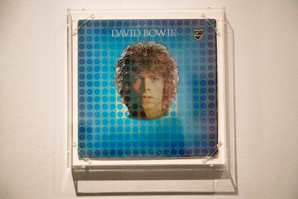 """. The \""""Space Oddity\"""" album cover is on display during the media preview of the \""""David Bowie is\"""" exhibit at the Brooklyn Museum, Wednesday, Feb. 28, 2018, in New York. The exhibit opens to the public March 2 and runs through July 15, 2018. (AP Photo/Mary Altaffer)"""