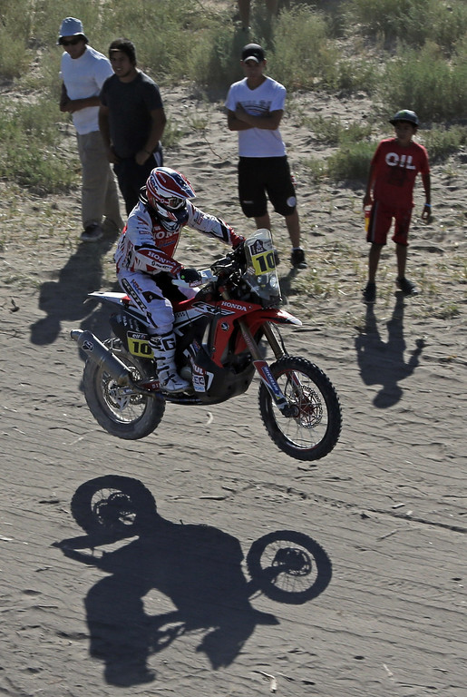 . Paulo Goncalves of Portugal powers his Honda motorcycle during the Dakar Rally 2014 Stage 2 from San Luis to San Rafael, on January 6, 2014.      JEAN-PAUL PELISSIER/AFP/Getty Images