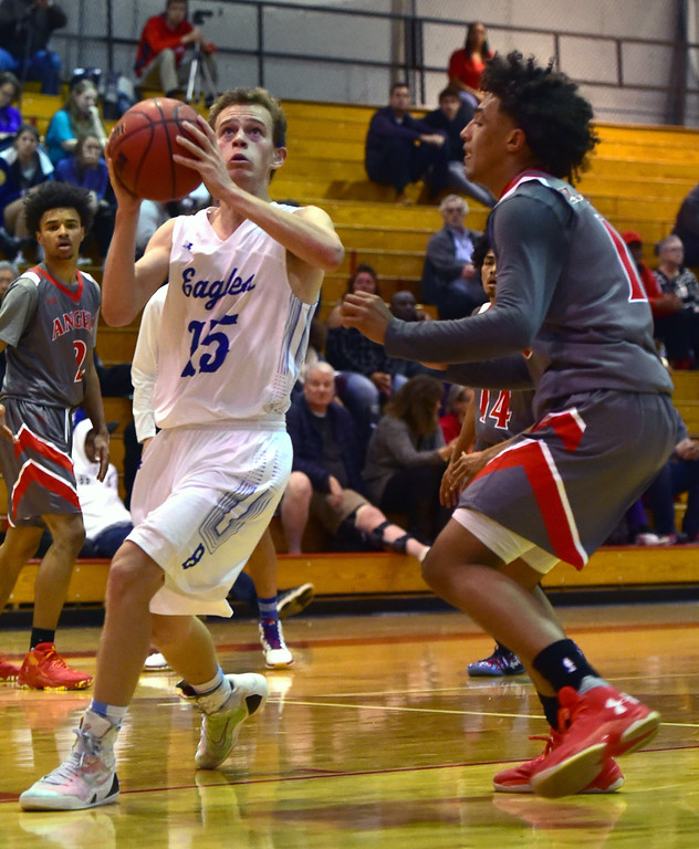 . Broomfield High School\'s Michael Georgiton looks to the basket as Denver East\'s Kwane Marble II defends during their game in the Fairview Festival on Wednesday. For More photos go to bocopreps.com Paul Aiken Staff Photographer Dec 6 2017