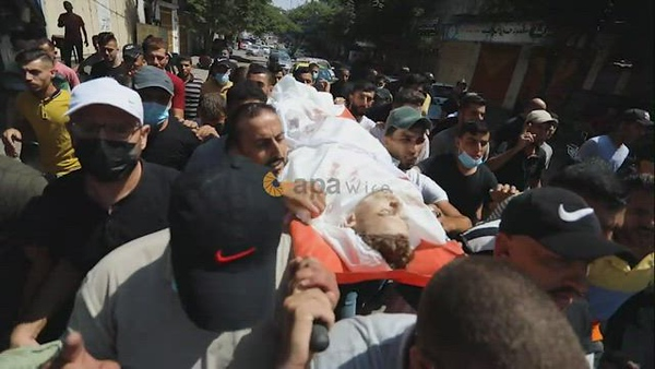 Mourners attend the funeral of Palestinian Ahmed Saleh, who was shot dead by Israeli troops