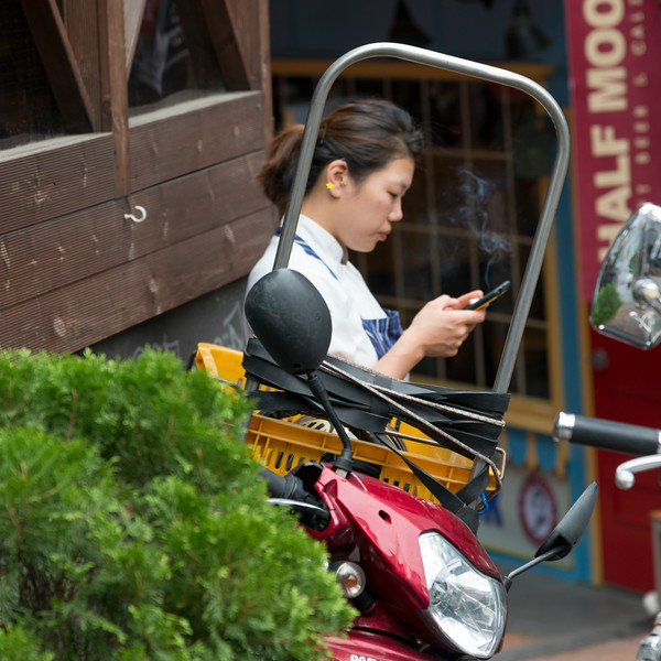 Woman using mobile phone, Seoul, South Korea